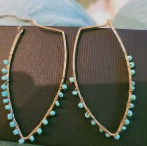 Wrapped turquoise gold plated earrings.